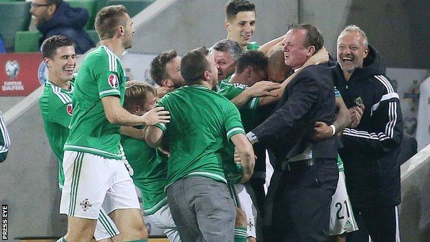 A Northern Ireland fan made an incursion onto the pitch after Josh Magennis scored against Greece