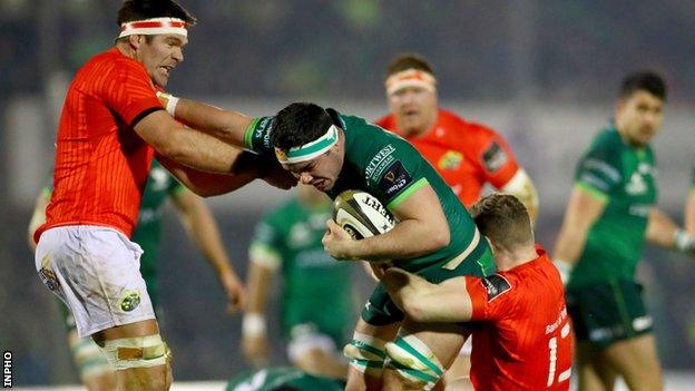 Munster's Billy Holland and Chris Farrell tackle Connacht's Paul Boyle