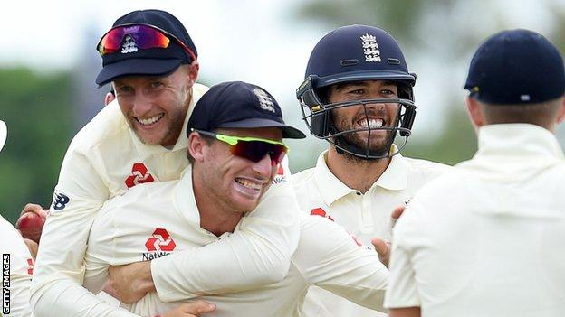 England celebrate led by Joe Root and Jos Buttler