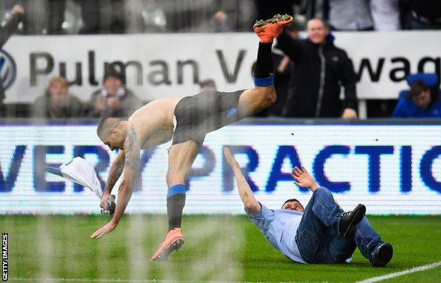 Aleksandar Mitrovic jumps over a fan
