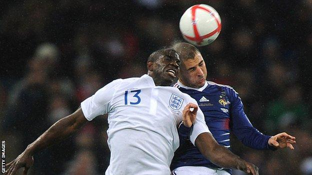 Micah Richards challenges France's Karim Benzema