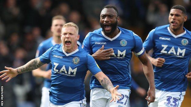 Macclesfield Town players celebrate scoring against Cambridge United