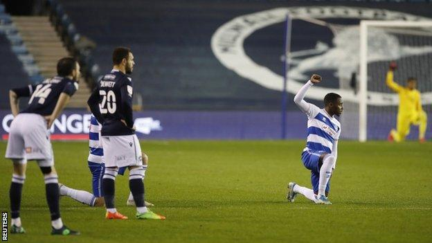 QPR players taking a knee before their game with Millwall on 8 December 2020, while Millwall players remained stood