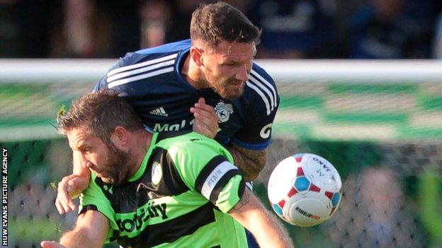 Sean Morrison (right) challenges former Cardiff striker Jon Parkin in a pre-season friendly against Forest Green Rovers