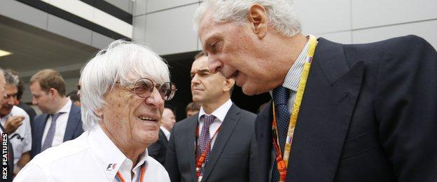 Bernie Ecclestone, CEO and President, FOM talks with Marco Tronchetti Provera of Pirelli on the grid.