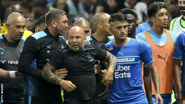 Marseille boss Jorge Sampaoli had to be held back by his staff during the trouble