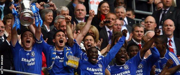 John Terry celebrates winning the FA Cup with Chelsea team mates in 2009