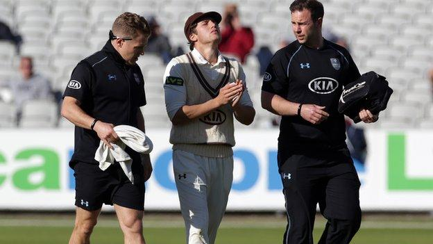 Zafar Ansari left the field with the Surrey physios after suffering his injury trying to stop an Ashwell Prince cover drive in mid-afternoon