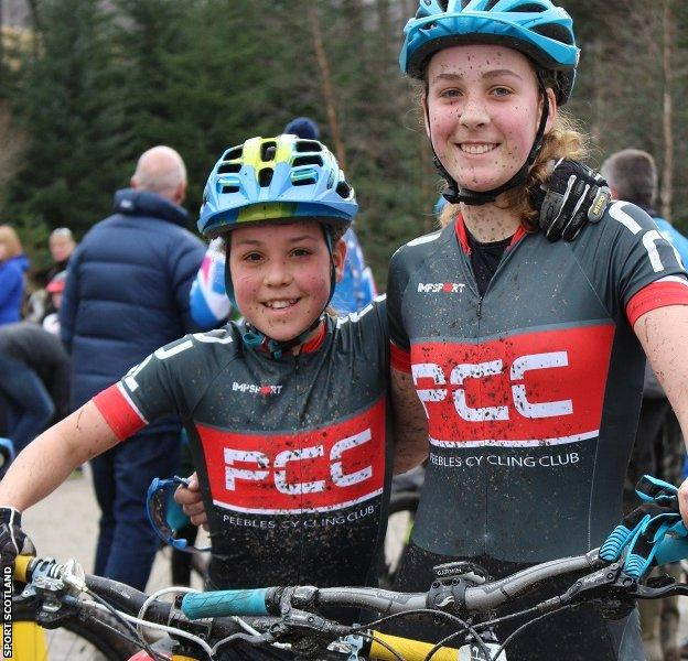 Mud and smiles: Elena and Anna compete regularly in mountain-bike criterium races