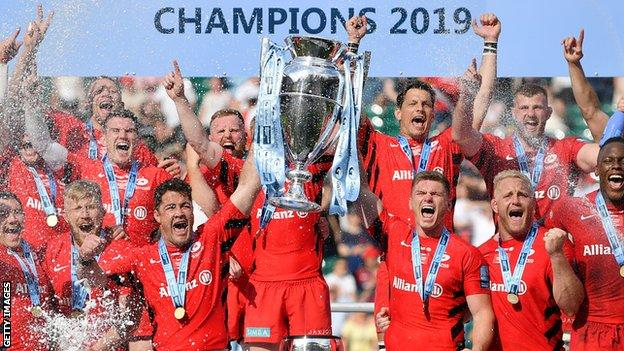 Brad Barritt and Owen Farrell of Saracens lift the trophy after winning the the Gallagher Premiership final against Exeter