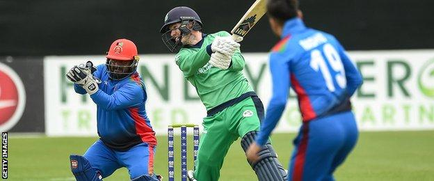 Afghanistan wicketkeeper Mohammad Shahzad and Ireland batsman George Dockrell