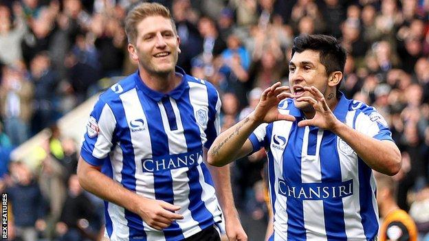 Fernando Forestieri (right) celebrates his first-half goal against Hull City