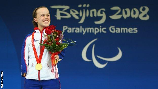 Ellie Simmonds on the medal podium in Beijing
