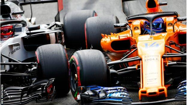 Kevin Magnussen and Fernando Alonso clash on track during Italian GP qualifying