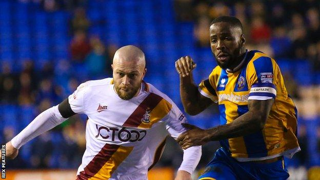 Abu Ogogo in action for Shrewsbury Town against Bradford City
