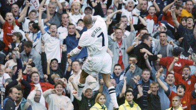 David Beckham celebrates in front of fans, 2001.