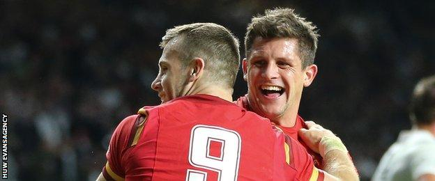 Gareth Davies and Lloyd Williams celebrate as Wales beat England at the 2015 World Cup