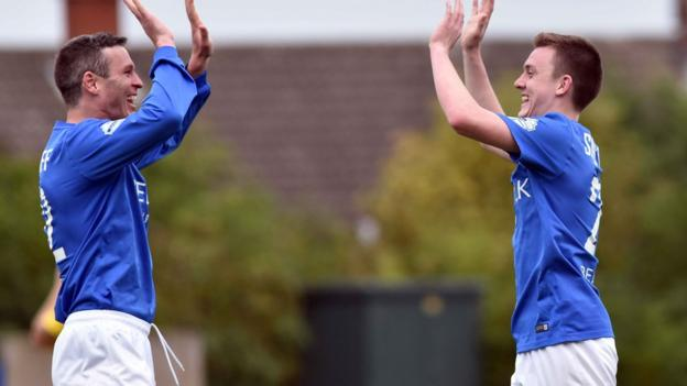Kevin Braniff and James Singleton celebrate a goal during Glenavon's 3-1 win over Dungannon Swifts