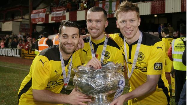 Cliftonville goalscorers David McDaid, Martin Donnelly and Stephen Garrett pictured with the cup after the game