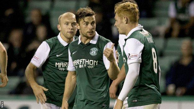 Hibernian's Fraser Fyvie (right) is congratulated by team-mate Lewis Stevenson after his cross is turned into the net by Stranraer's Scott Rumsby