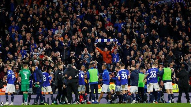Oldham fans celebrate