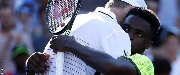 John Isner of the US (L) and Frances Tiafoe of the US