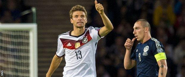 Thomas Muller (left) scored twice as Scotland fell short against Germany