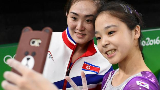Lee Goim of South Korea takes a selfie with Hong Un Jong of North Korea.