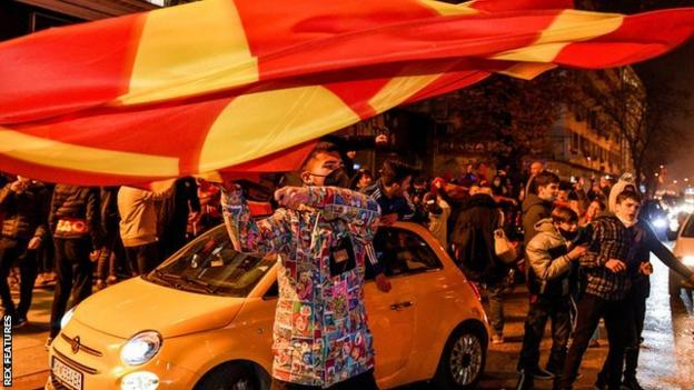 Fans celebrate North Macedonia qualifying for Euro 2020 on the streets of the capital Skopje
