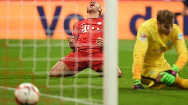 Thiago Alcantara celebrates scoring for Bayern Munich