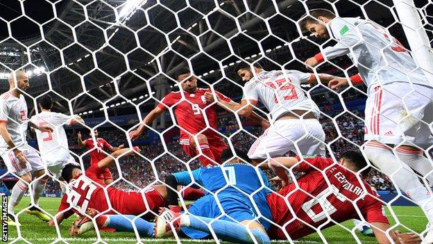 Iran somehow denied Gerard Pique in a chaotic goalmouth scramble