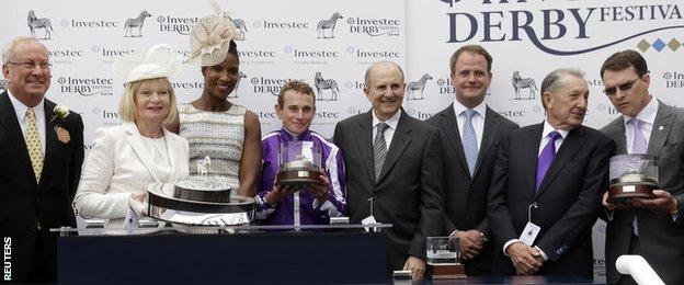 Ryan Moore (centre in purple) with the Oaks trophy