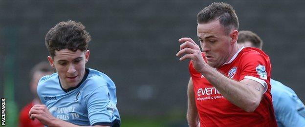 Institute's Callum Moorehead in action against Darren McCauley of Coleraine