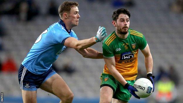 Donegal's Ryan McHugh battles with Donegal's Paul Mannion