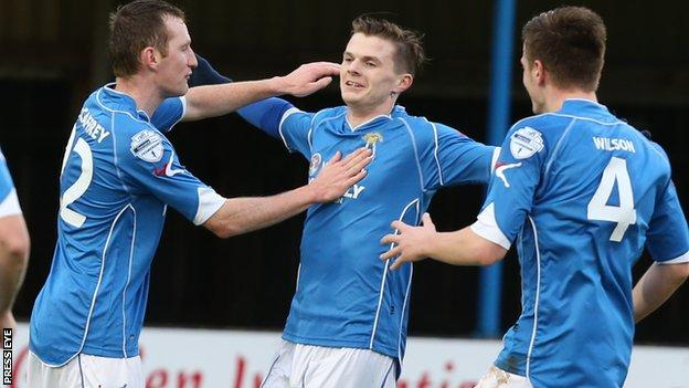 Dungannon striker Paul McElroy celebrates scoring against Warrenpoint