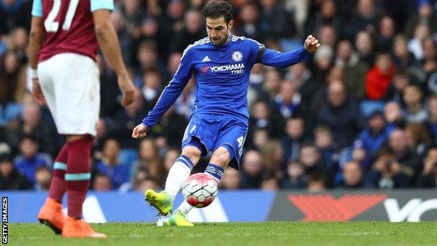 Cesc Fabregas scores from a free-kick
