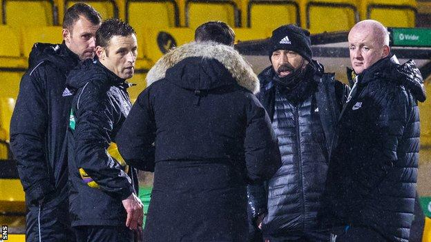 Referee McLean speaks to managers Derek McInnes and David Martindale