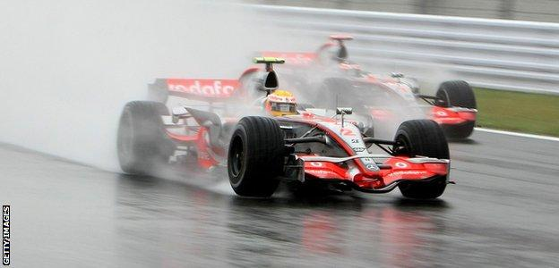 Lewis Hamilton drives through the wet conditions on his way to winning the 2007 Japanese Formula 1 Grand Prix at the Fuji Speedway