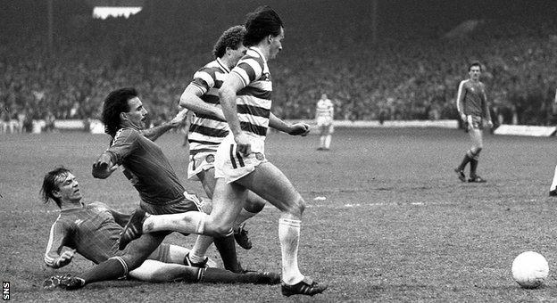 Aberdeen defenders Alex McLeish and Willie Miller slide in to tackle Celtic's Davie Provan and Charlie Nicholas.