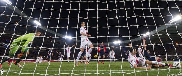 Robert Lewandowski scores for Poland against Scotland