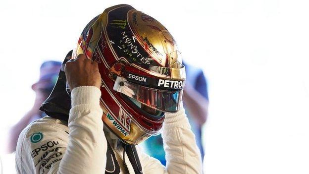 Lewis Hamilton wearing his golden helmet