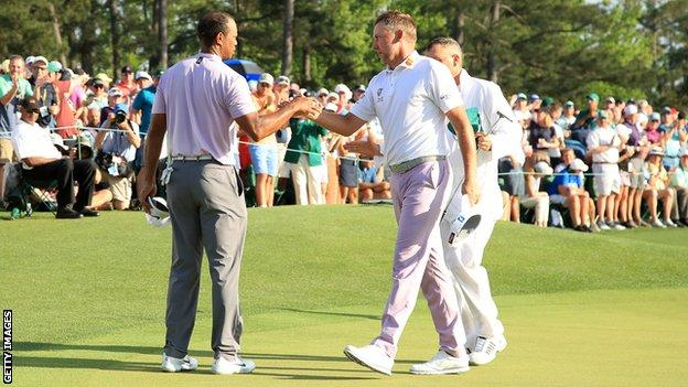 Ian Poulter and Tiger Woods during the third round of the 2019 Masters at Augusta