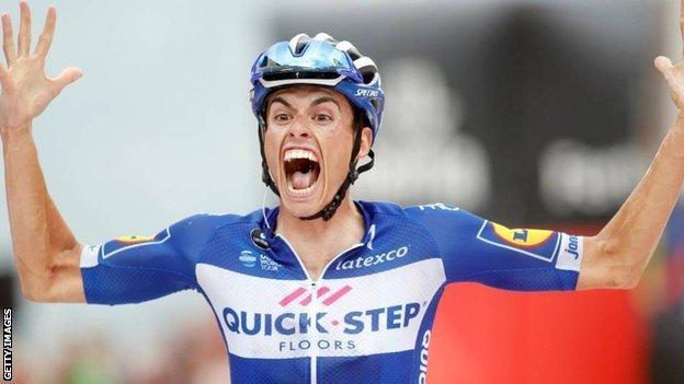 Enric Mas celebrates winning stage 20