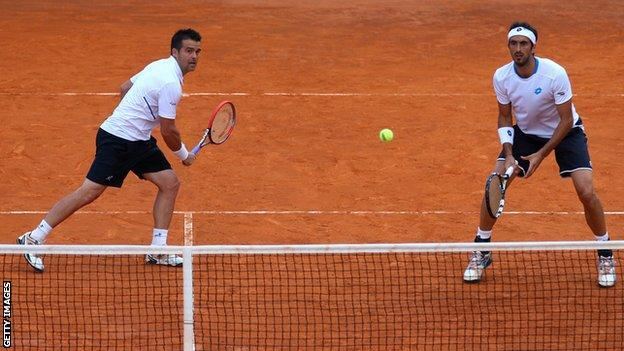 Daniele Bracciali of Italy and Potito Starace of Italy in action in the doubles against Max Mirnyi of Belarus and Mikhail Youzhny of Russia during day three of the Internazionali BNL d'Italia tennis 2014 on May 13, 2014