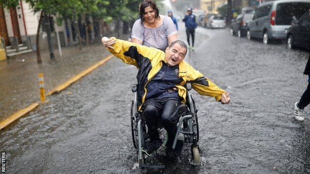 Boca Juniors fan in the rain