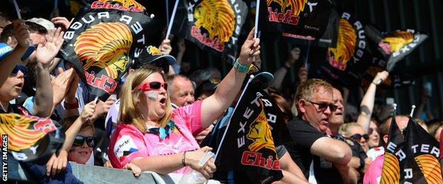 Exeter Chiefs fans wave flags during the 2018 Premiership semi-final against Newcastle