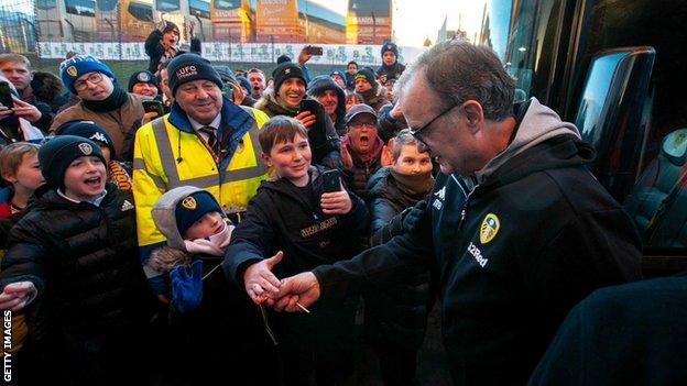 Marcelo Bielsa greeted by fans