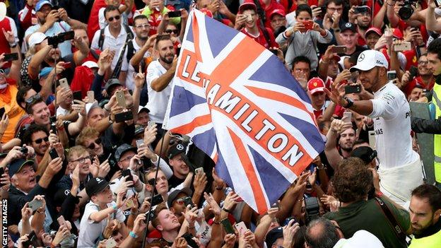 Lewis Hamilton waves to the crowds at Monza