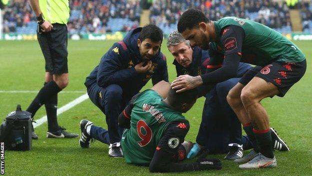 Wesley receiving treatment on the pitch at Turf Moor