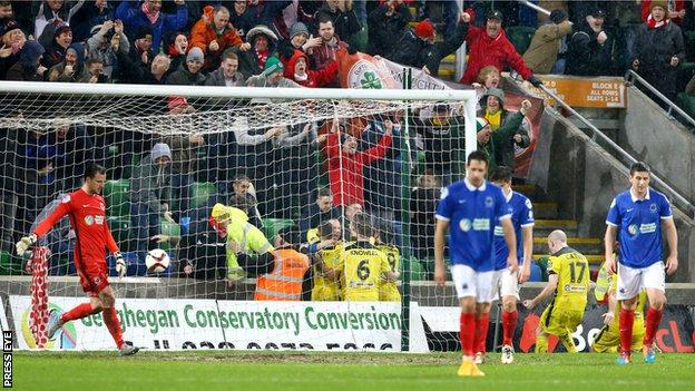Cliftonville fans celebrate at Windsor Park after Jay Donnelly score the winning goal